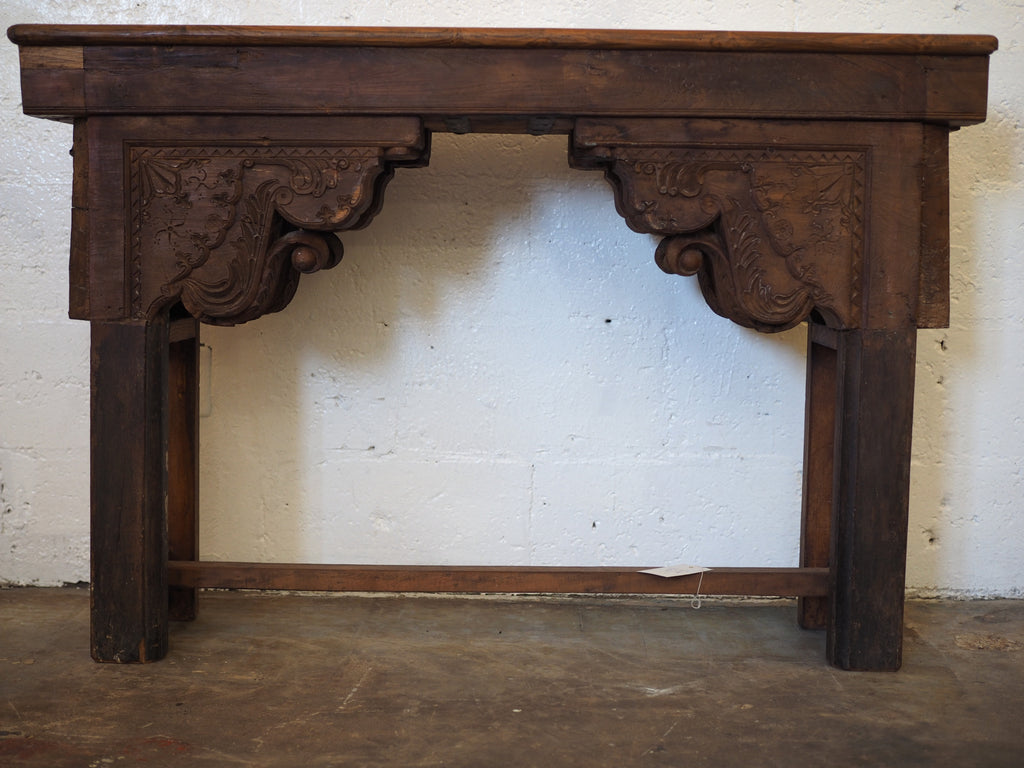 Hand carved fire mantle console