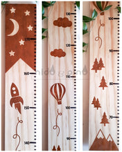 Height chart with wood stain shapes