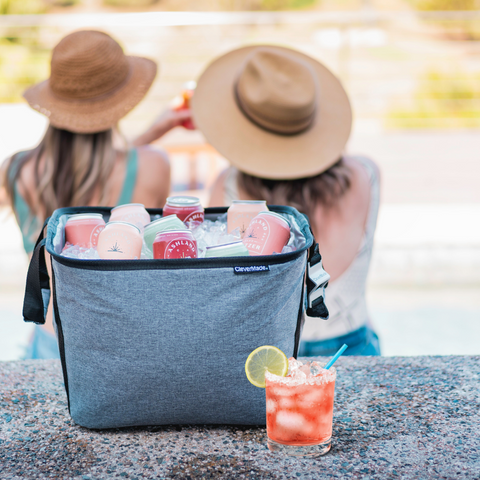 clevermade party tub with a margarita and girls sitting by the pool