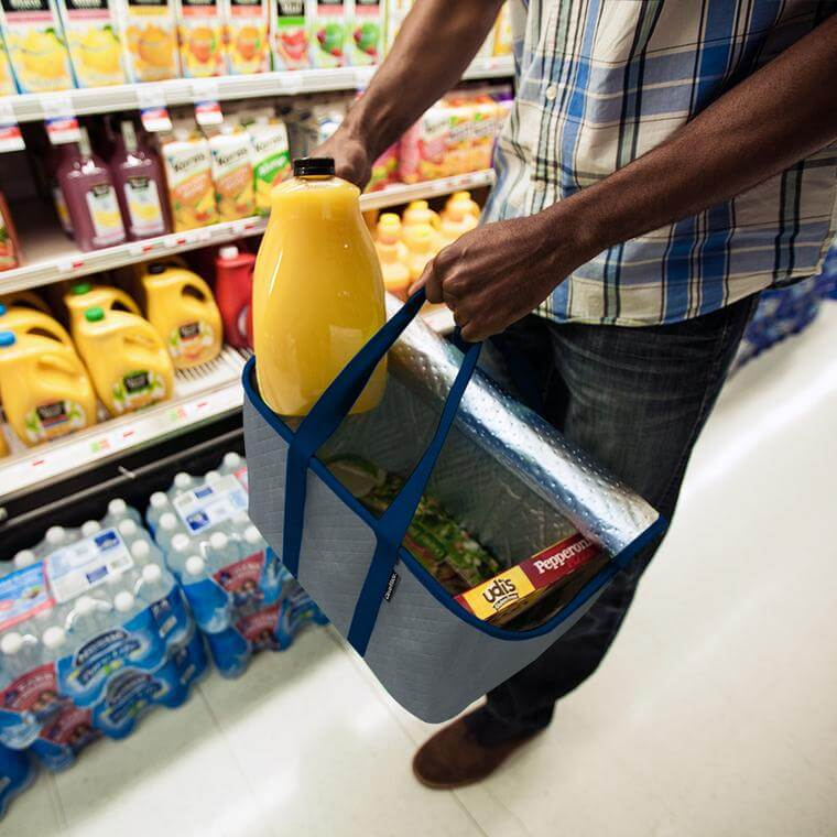 Man putting groceries inside his SnapBasket Thermo Tote