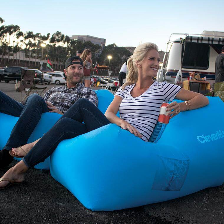 man and woman tailgating on two QuickFill AirChairs in Blue