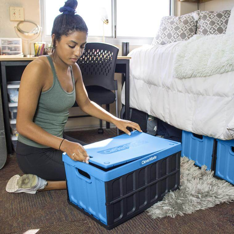 College student storing items in a CleverCrate® Storage Bin with Lid
