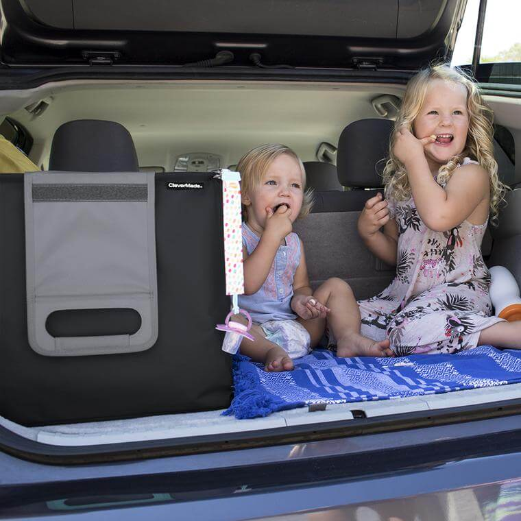 kids in the trunk of a car next to the Trunk Caddy
