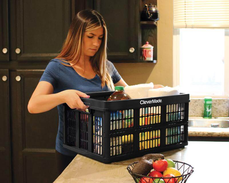 Woman in kitchen with CleverCrate® Utility Crate in Black