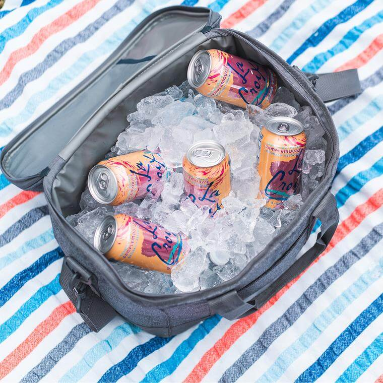 Seaside Cooler filled with ice and cans
