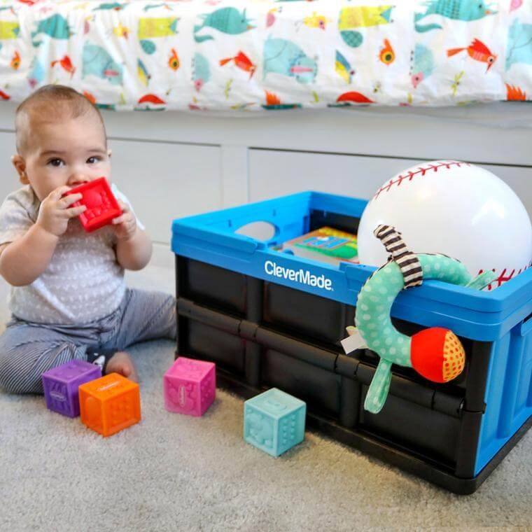 baby with toys in a CleverCrate® Shopping Bin