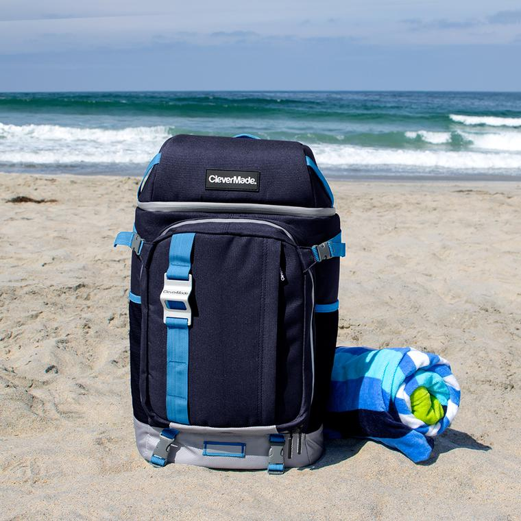 Cardiff Backpack Cooler on a sandy beach.