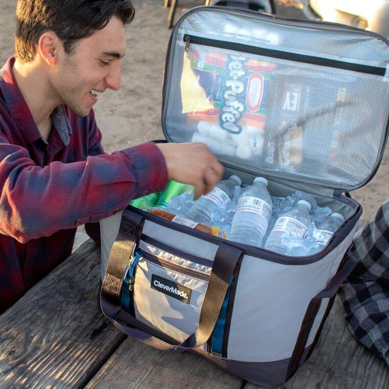 Man with Maverick Cooler full of ice and water bottles
