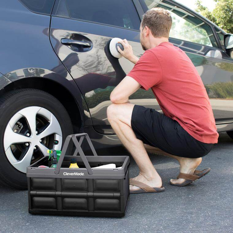 man waxing his car with supplies in a CleverCrate® Shopping Bin