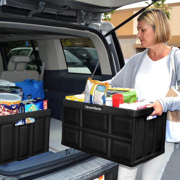 woman carrying groceries in a CleverCrate® Storage Bin in Black