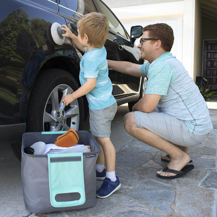 Dad and son wax a car with supplies in the Trunk Caddy