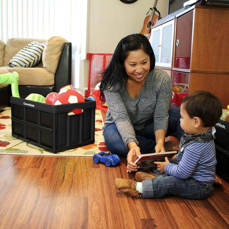 woman and son next to a CleverCrate® Storage Bin filled with toys