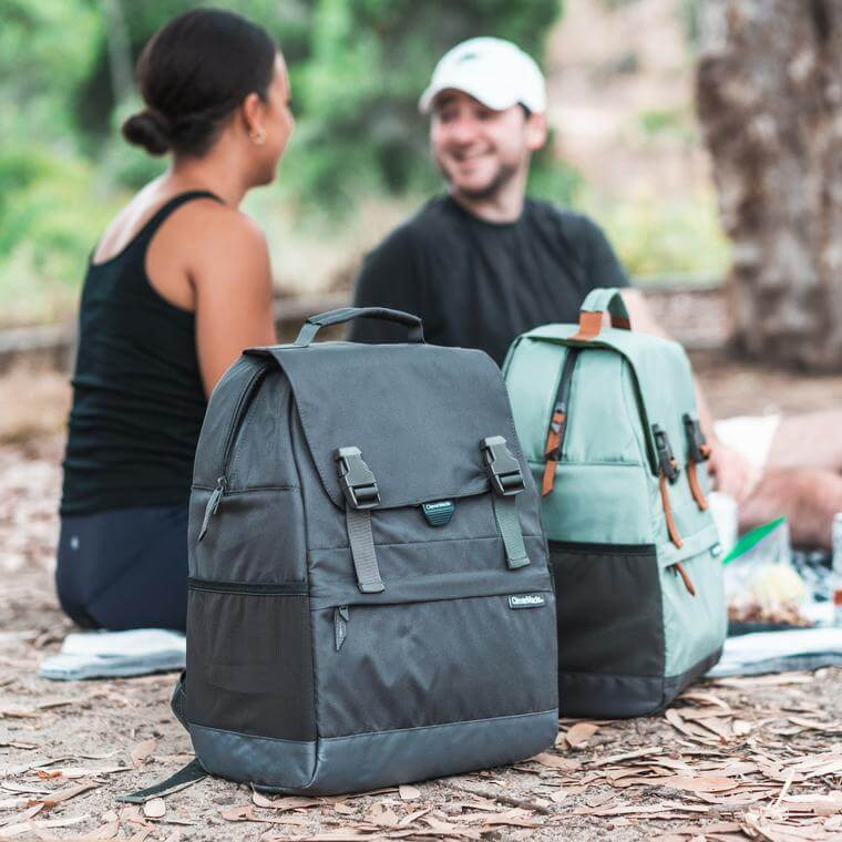 Two people on a hike with the Solana Backpack Cooler