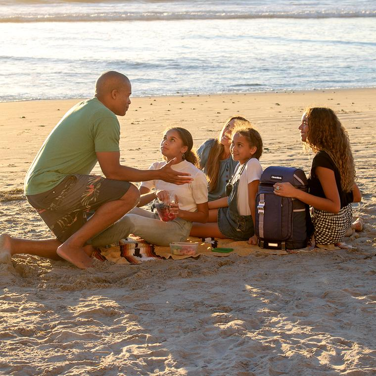 Family at the beach with Cardiff Backpack Cooler.