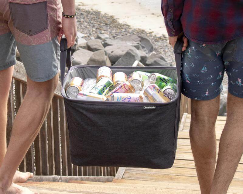Two men carrying the filled PartyTub