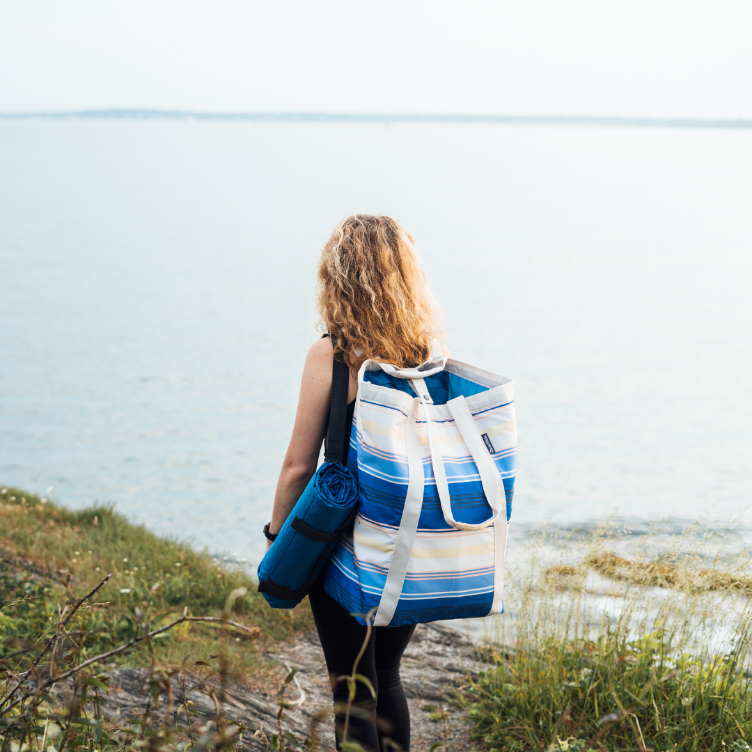 Backsak Beach Tote and Pack & Go Blanket on a Girl