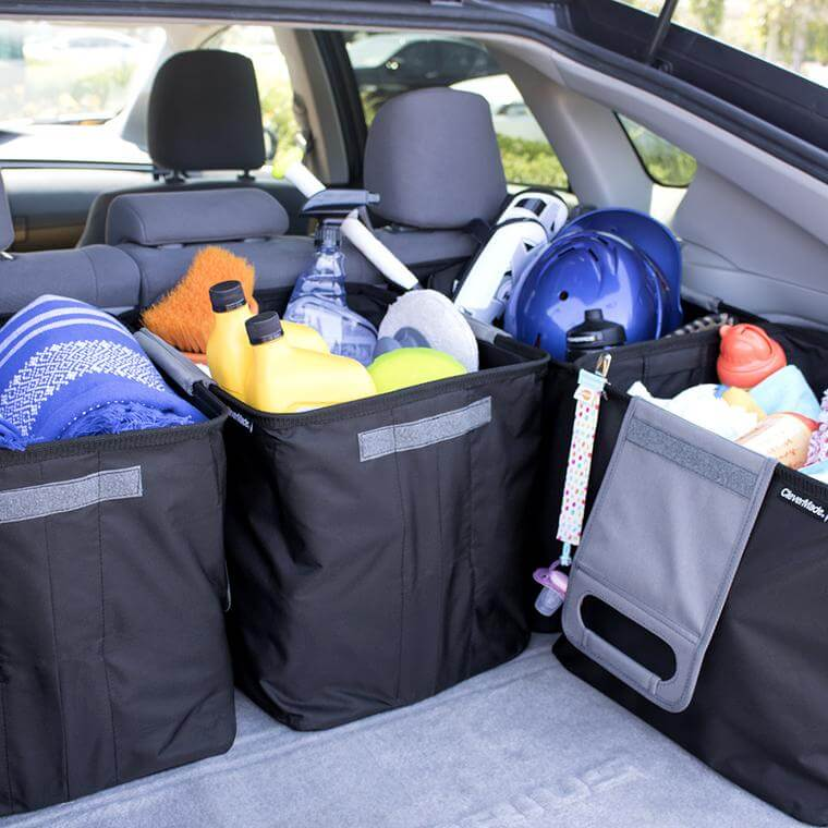 Trunk of a car with 4 Trunk Caddies together full of items
