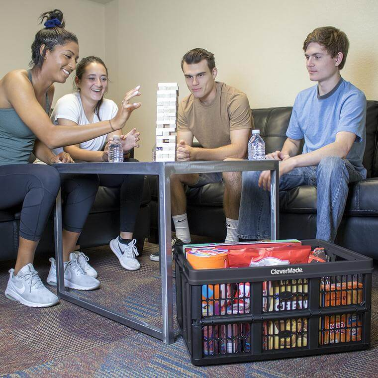 College students with snacks inside a CleverCrate® Utility Crate in Black
