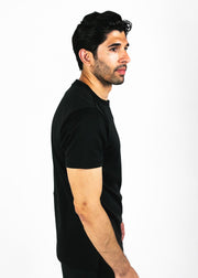 black heavyweight tee - side facing model