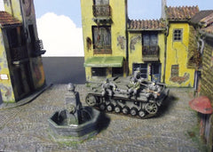 1/72 German military figures in Italian village square diorama.