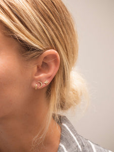 Woman wearing earring stackers