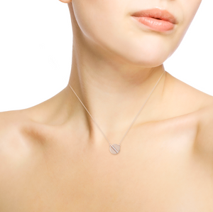 diamond token necklace on model