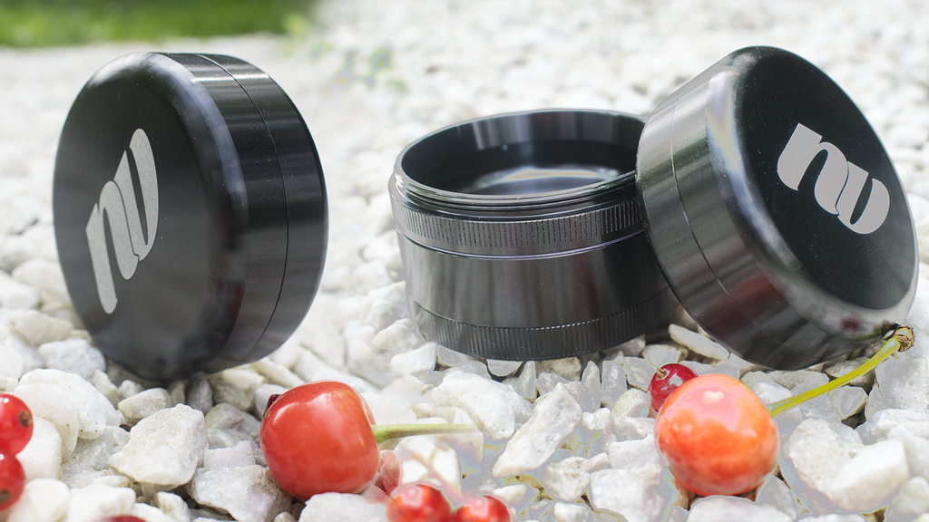 Grinder with storage compartment