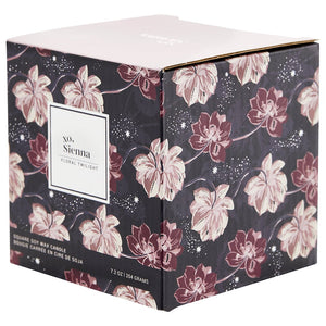 Soy wax candle in a floral container
