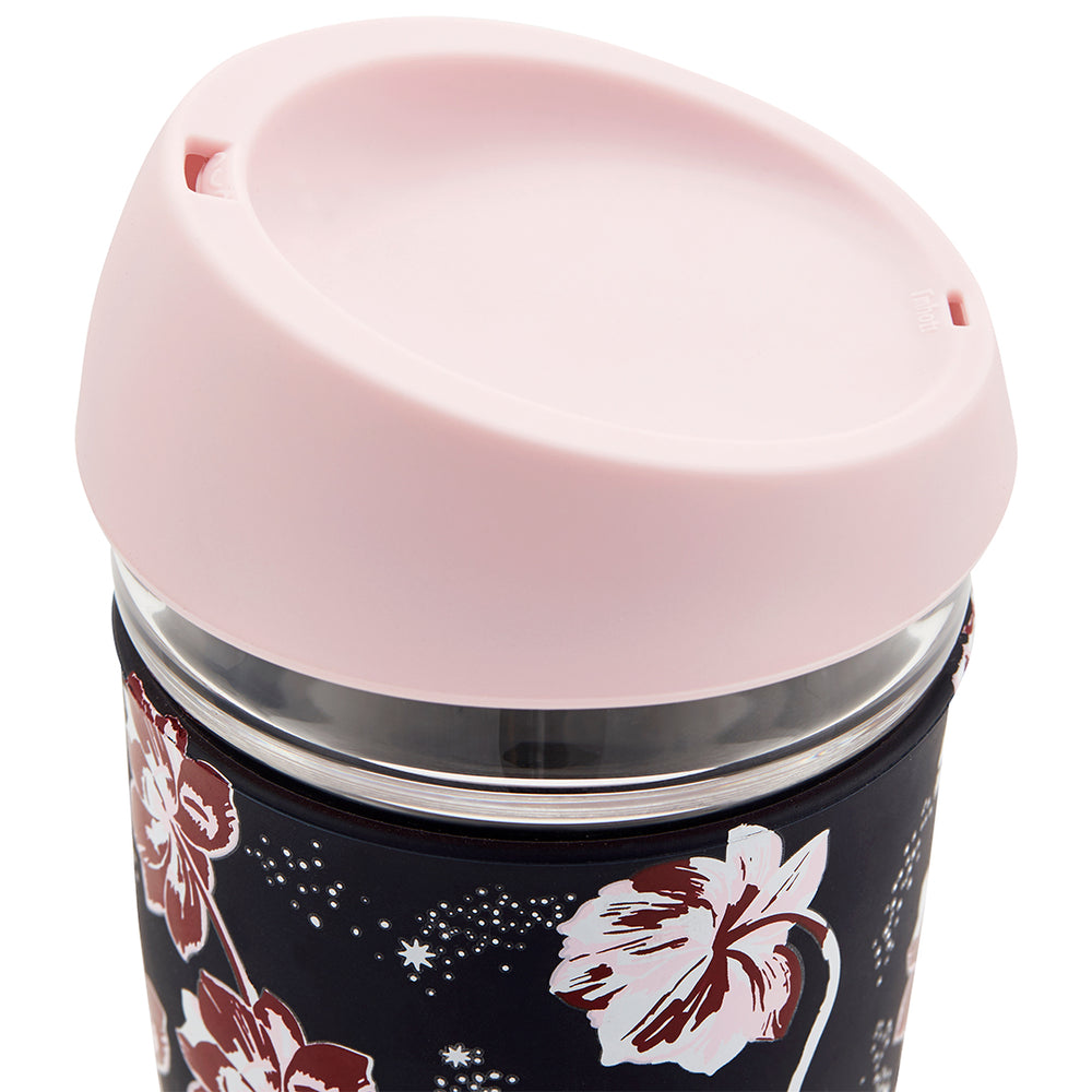 Glass travel mug with a floral printed silicone case
