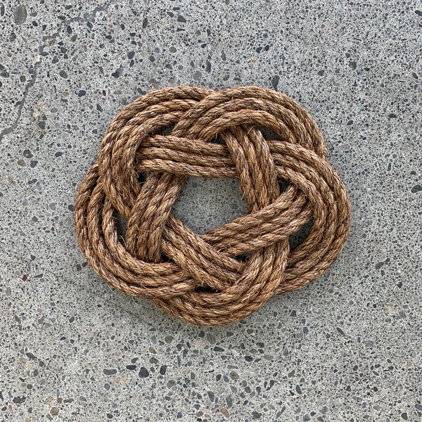 Hand knotted rope trivet or pot stand. Protect your surfaces from hot pots