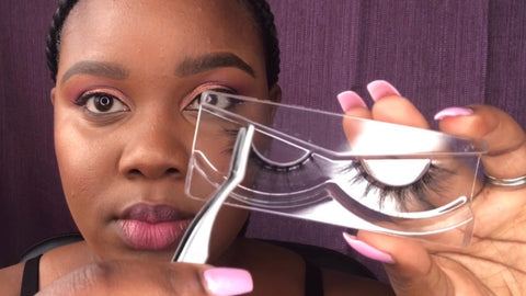 false lash application: step 1, gently remove from lash tray