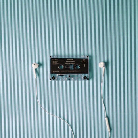 Listening - image of music casette and earphones