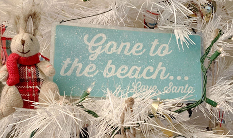 Gone to the beach sign on a Christmas tree