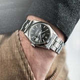 Rolex Date Reference 1500 Grey Dial wrist shot on oyster bracelet