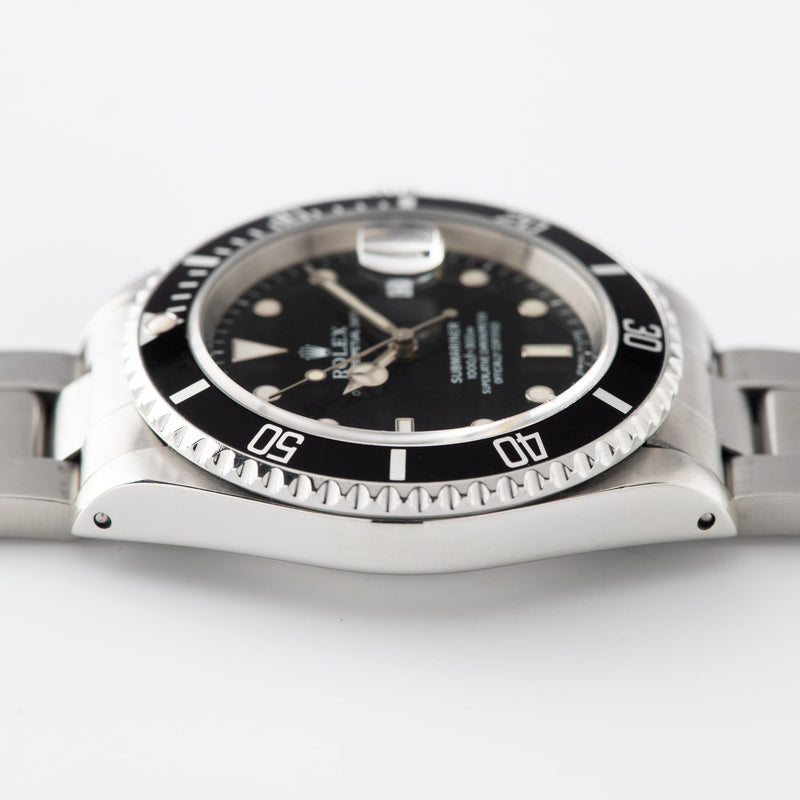 Rolex Submariner Date Reference 16610 with Papers and modern sapphire glass