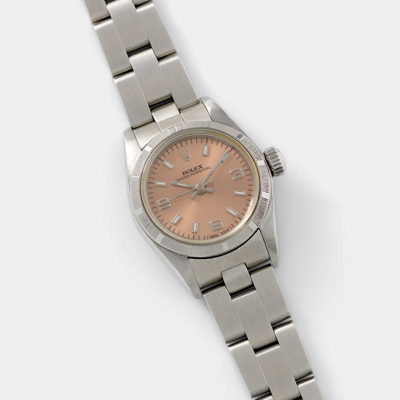 Rolex Oyster Perpetual Lady Ref 67230 Salmon Dial with engine-tuned bezel