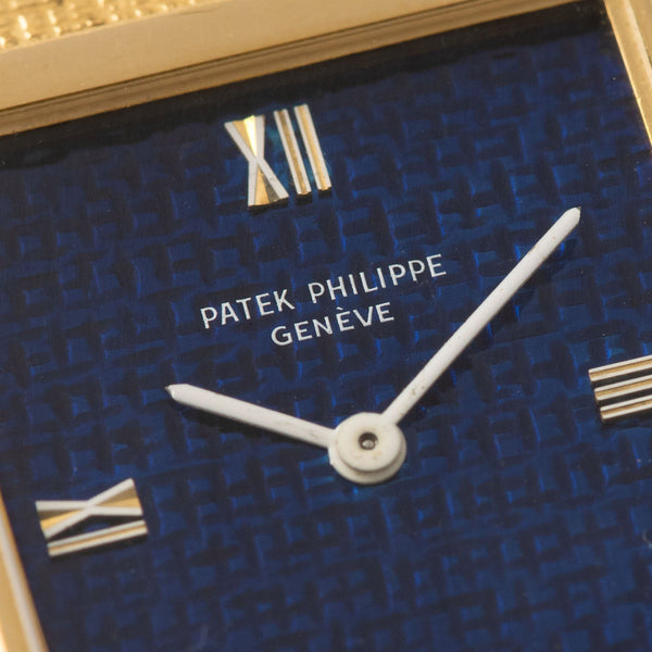 Patek Philippe Yellow Gold Dress Watch Reference 3491 with Cool blue 'waves' dial