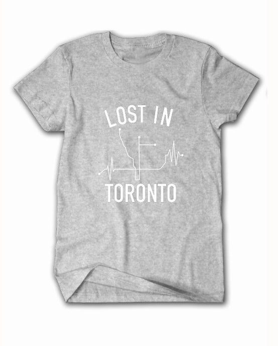 Stay connected to everything Toronto has to offer in our classic LOST IN O.G tee reppin' Toronto's subway systems connecting to the major districts, hubs, and neighborhoods in the 6!   Available in Black, White & Grey 100% Pre-Shrunk Cotton Unisex Screenprint graphic