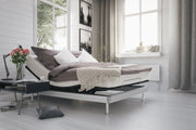 The SilverStandard Adjustable Bed in a bedroom.