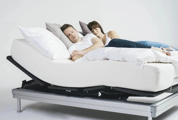A couple sleeps comfortably on their Adjustable Platform Bed.