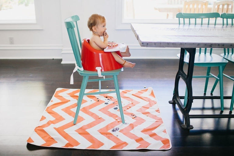 "catchALL™ floor mat Chevron Orange and White___ wipe clean; non-slip; great for meals, crafts or haircut (42"" x 42"") Barcode: 049345003079 HTC: 3926909790 Unit Weight: 0.307kg. Volume: 0.001cbm. Country of origin: China - Prince Lionheart UK"