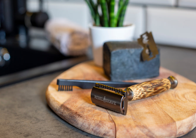 black safety razor kit on wooden board in bathrrom