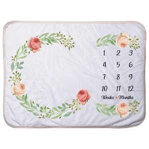 we care vida milestone blanket with floral design