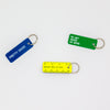 "Three key tags shown together, blue tag states ""pretty good"", green tag states ""no nay never no more"" and yellow tag looks like a mini ruler and states ""measure twice cut once"""