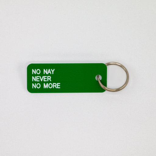 "green rectangular key tag is made from acrylic and states ""no nay never no more"""