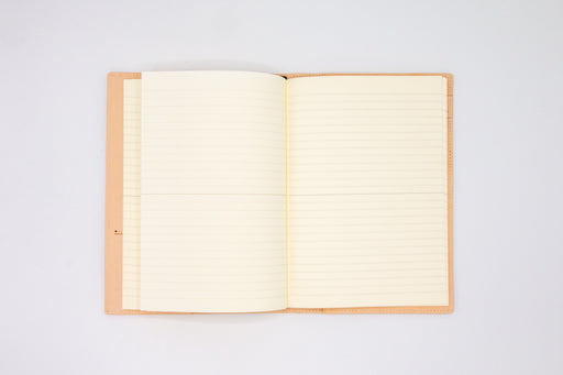 Double page spread of lined ivory page inside goat leather notebook