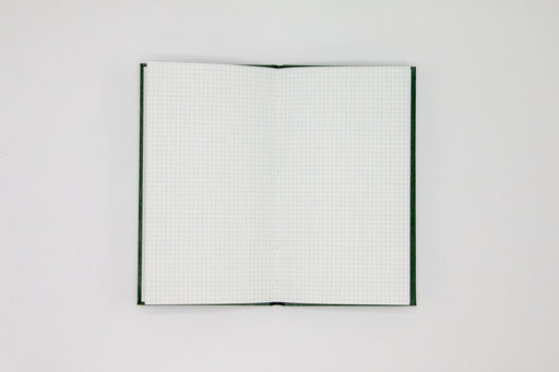Double page spread of grid pages inside Japanese green sketch book