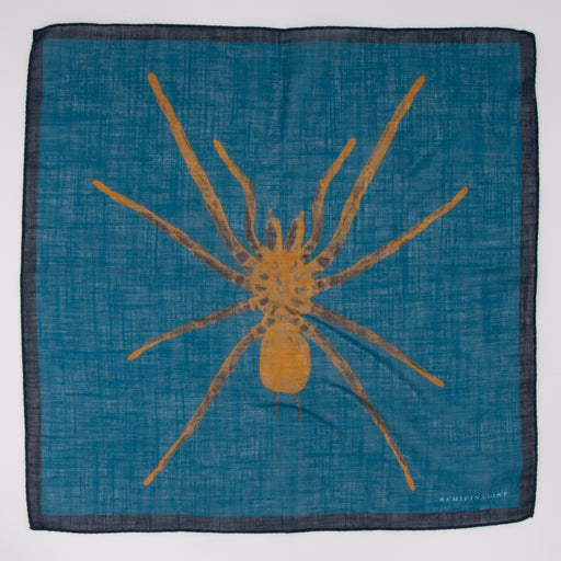 Yellow spider on blue cotton and linen square