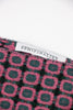 Close up of semifinalist logo on green and pink geometric cashmere scarf