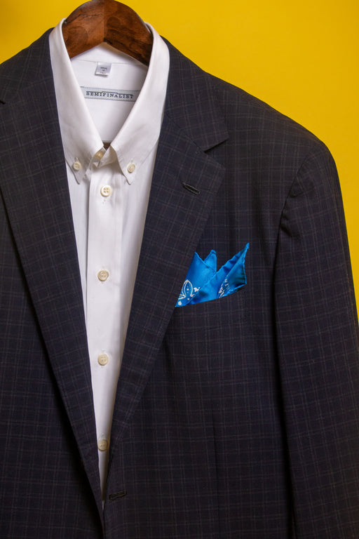 Classic blue silk bandana in jacket pocket